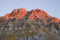 Peak at sunset a of vardousia mountain turning into red by the rays of the setting sun Stock Image
