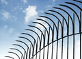 Peaked fence on blue sky Royalty Free Stock Photo