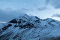 Peaks of Austrian alps and a moon in summer Royalty Free Stock Photo