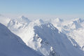 Peaks of mountains mountain winter alps under blue sky Stock Image