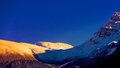 Peaks snow covered mountain on a sunny winter day with a clear sky Royalty Free Stock Image
