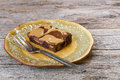 Peanut butter and chocolate brownies sheet cake with milk swirled topping with plate Stock Photography