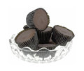 Peanut butter cups dish a group of in ridged paper wrappers in a decorative glass bowl Stock Image