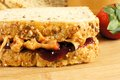 Peanut butter and jelly sandwich close up on wooden background Royalty Free Stock Photos