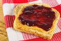 Peanut butter and jelly on whole wheat bread Stock Images