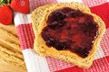 Peanut butter and jelly on whole wheat bread with checkered cloth Royalty Free Stock Image
