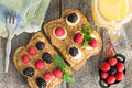 Peanut butter sandwiches with berries and cheese overhead view of healthy on wholewheat bread topped fresh raspberries Stock Photography