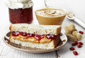 Peanut butter and strawberry jelly sandwich Royalty Free Stock Images