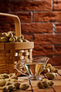 Peanuts in basket and on the table Royalty Free Stock Photos