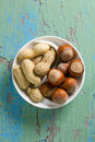 Peanuts and hazelnuts Stock Images