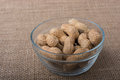 Peanuts in a plate on canvas Royalty Free Stock Photo