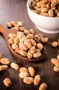 Peanuts on table selective focus the in wooden ladle Royalty Free Stock Photo