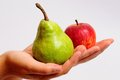 Pear or apple and being offered Royalty Free Stock Photos