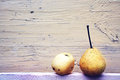 Pear and apple on wooden background Stock Photo