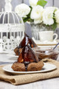 Pear in cake with chocolate sauce festive and party dessert Stock Image
