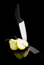 Pear and ceramic knife. Stock Photography