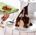 Pear with chocolate sauce Stock Image