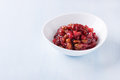 Pear cranberry relish for christmas in a white bowl over light blue background with copy space Stock Photos