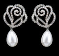 Pear diamonds earrings on black background on black background Stock Image