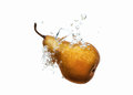 Pear dropped into water splash on white Royalty Free Stock Photo