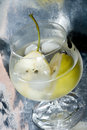 Pear in glass with martini Royalty Free Stock Images