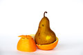 Pear inside an orange gmo are living organisms whose genetic material has been altered to enhance some qualities over others Royalty Free Stock Images