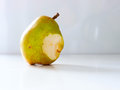 Pear nibble the green vegetable Royalty Free Stock Photo