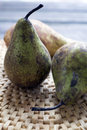Pear pears on a wicker mat Stock Image