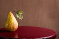 Pear on a rustic stool Stock Photo