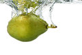 Pear in water sinking into on white Royalty Free Stock Photography