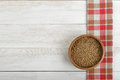 Pearl barley in a pot and red checkered tablecloths with copy space . Top view Royalty Free Stock Photo