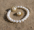 Pearl bracelet and earrings lying Royalty Free Stock Photo