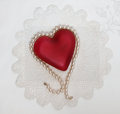 Pearl draped heart on doily red glass with cultured pearls antique handmade Stock Photos