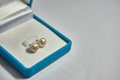 Pearl earring in the blue velvet jewelry box. Royalty Free Stock Photo