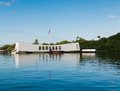 Pearl harbor memorial with flag reflected in the water Stock Photos