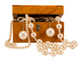Pearl jewelry in retro wooden box isolate on white Royalty Free Stock Photo