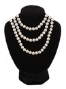 Pearl necklace on black mannequin isolated Royalty Free Stock Photo
