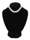 Pearl necklace on black mannequin isolated over white Royalty Free Stock Photo