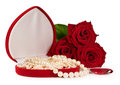 Pearl necklace in a gift box with a bouquet of red roses isolated on white Stock Images