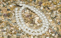 Pearl Necklace on gravels Royalty Free Stock Photography