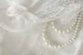 Pearl necklace on lace background. Royalty Free Stock Photo