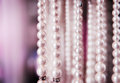 Pearl necklaces for sale fake hanging in shop Stock Photography