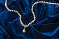 Pearls on blue velvet Royalty Free Stock Photo