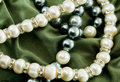 Pearls on green cloth Royalty Free Stock Image