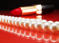 Pearls and lipstick Royalty Free Stock Photo