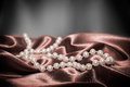 Pearls on a silk fabric background Royalty Free Stock Photo