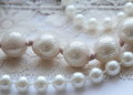 Pearls on white texture background Royalty Free Stock Images