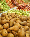 Pears apples bosc and in supermarket produce section display Royalty Free Stock Photos