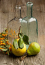 Pears, berry and old bottle Royalty Free Stock Photography