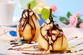 Pears with flaked almonds and chocolate sauce Stock Photography